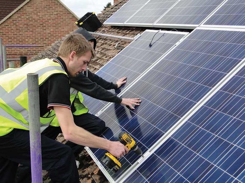 Man fitting solar panels